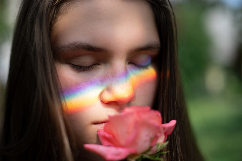 A woman smelling a flower